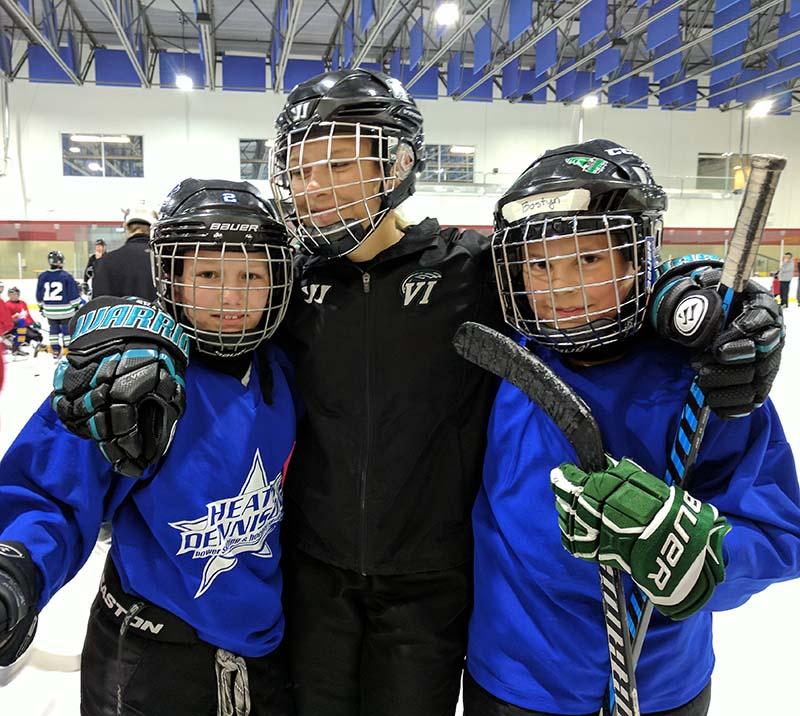 Players practice power skating and hockey drills at Heath Dennison school